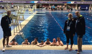 Team & coaches at pool